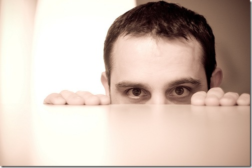 Man Peeking over Tabletop